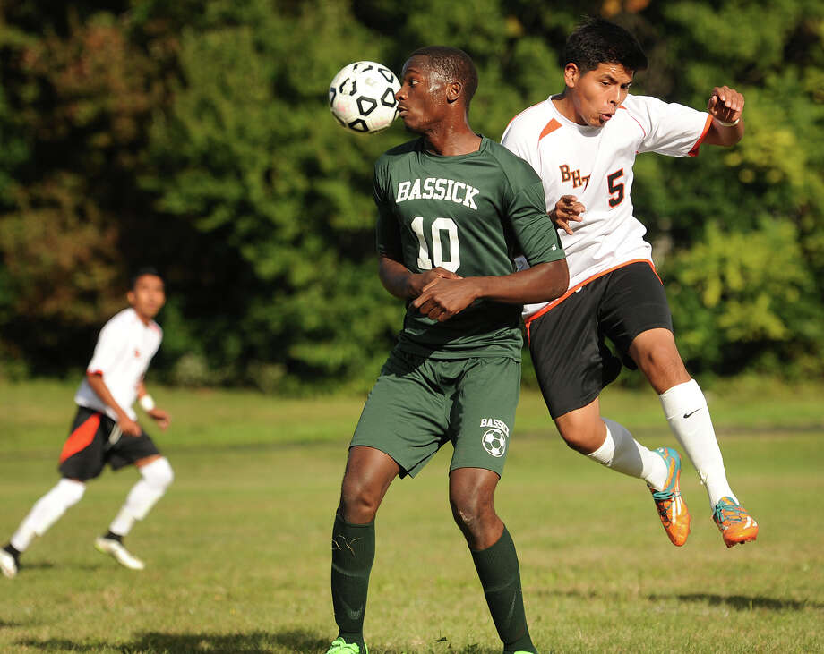Bassick's Enock Kalonji, left, and Bullard Havens' Danilo Lligicota play a high ball in the first half of their boys soccer match at Bullard Havens High School in Bridgeport, Conn. on Monday, October 5, 2015. Photo: Brian A. Pounds / Hearst Connecticut Media / Connecticut Post