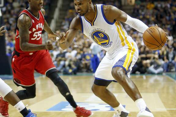 Golden State Warriors' Leandro Barbosa drives against Toronto Raptors' Delon Wright in 2n quarter of Warriors' 95-87 win during NBA preseason game at SAP Center in San Jose, Calif., on Sunday, October 5, 2015.