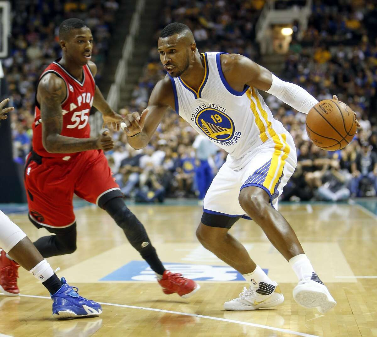 Golden State Warriors' Leandro Barbosa drives against Toronto Raptors' Delon Wright in 2n quarter of Warriors' 95-87 win during NBA preseason game at SAP Center in San Jose, Calif., on Sunday, October 5, 2015.