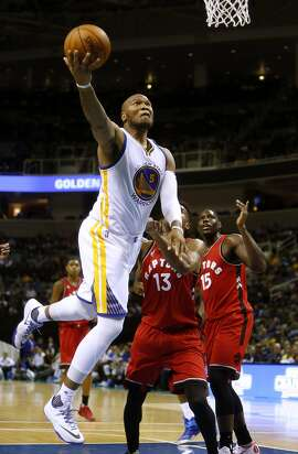 Golden State Warriors' Marreese Speights scores against Toronto Raptors' Ronald Roberts (13) and Anthony Bennett (15) during Warriors' 95-87 win in NBA preseason game at SAP Center in San Jose, Calif., on Sunday, October 5, 2015.