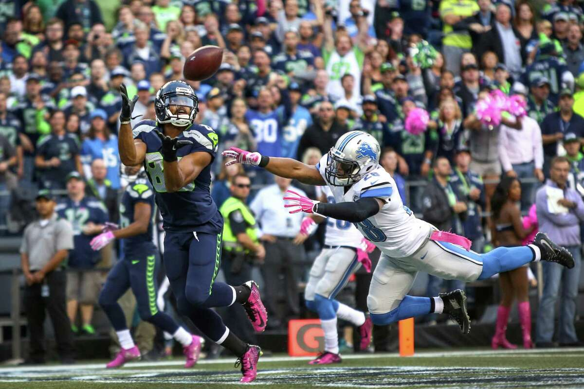 Seattle Seahawks player Doug Baldwin hauls in touchdown catch while defended by Detroit Lions Quandre Diggs during Monday Night Football on Monday, October 5, 2015. The Seahawks beat the Lions 13-10.