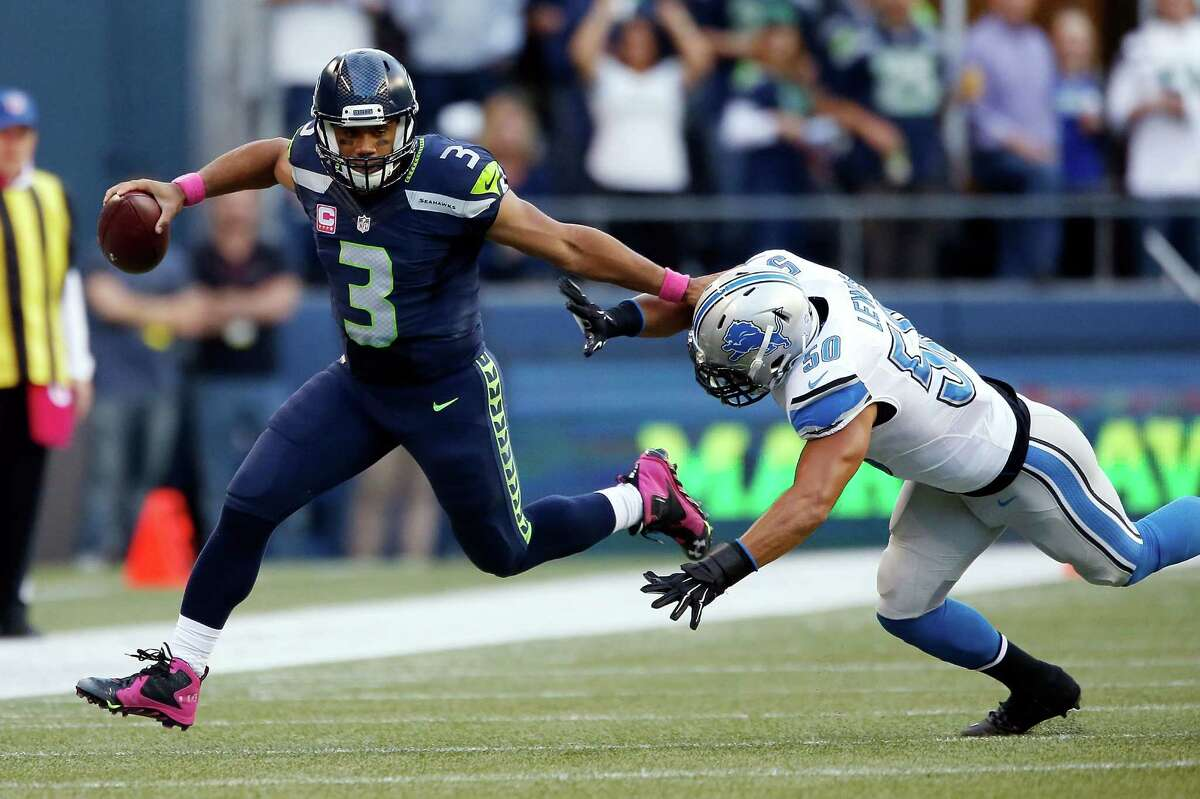 Russell Wilson was incredible, given his offensive line's performance Despite being forced out of the pocket constantly, Wilson completed 20 of 26 passes for 287 yards, a touchdown and no interceptions, while rushing 10 times for 40 yards. Yes, he could have gotten tight end Jimmy Graham more involved. Graham was targeted five times and had four catches for 29 yards. Yes, the two second-half fumbles kept the Lions in it. But there are few, if any, quarterbacks in the NFL who could have played that well behind an offensive line that anemic.