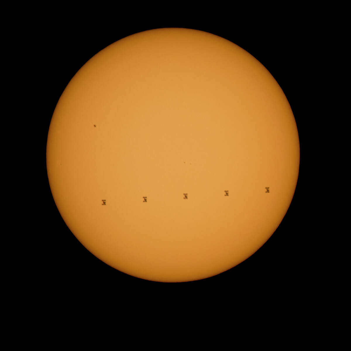 FRONT ROYAL, VA - SEPTEMBER 06: In this handout composite image provided by NASA, five frames show the International Space Station, with a crew of six onboard, in silhouette as it transits the sun at roughly five miles per second September 6, 2015, as seen from Shenandoah National Park in Front Royal, Virginia. Onboard the space station is NASA astronauts Scott Kelly, Kjell Lindgren, Russian Cosmonauts Gennady Padalka, Mikhail Kornienko, Oleg Kononenko, Sergey Volkov, Japanese astronaut Kimiya Yui, Danish Astronaut Andreas Mogensen and Kazakhstan Cosmonaut Aidyn Aimbetov. (Photo by Bill Ingalls/NASA via Getty Images)
