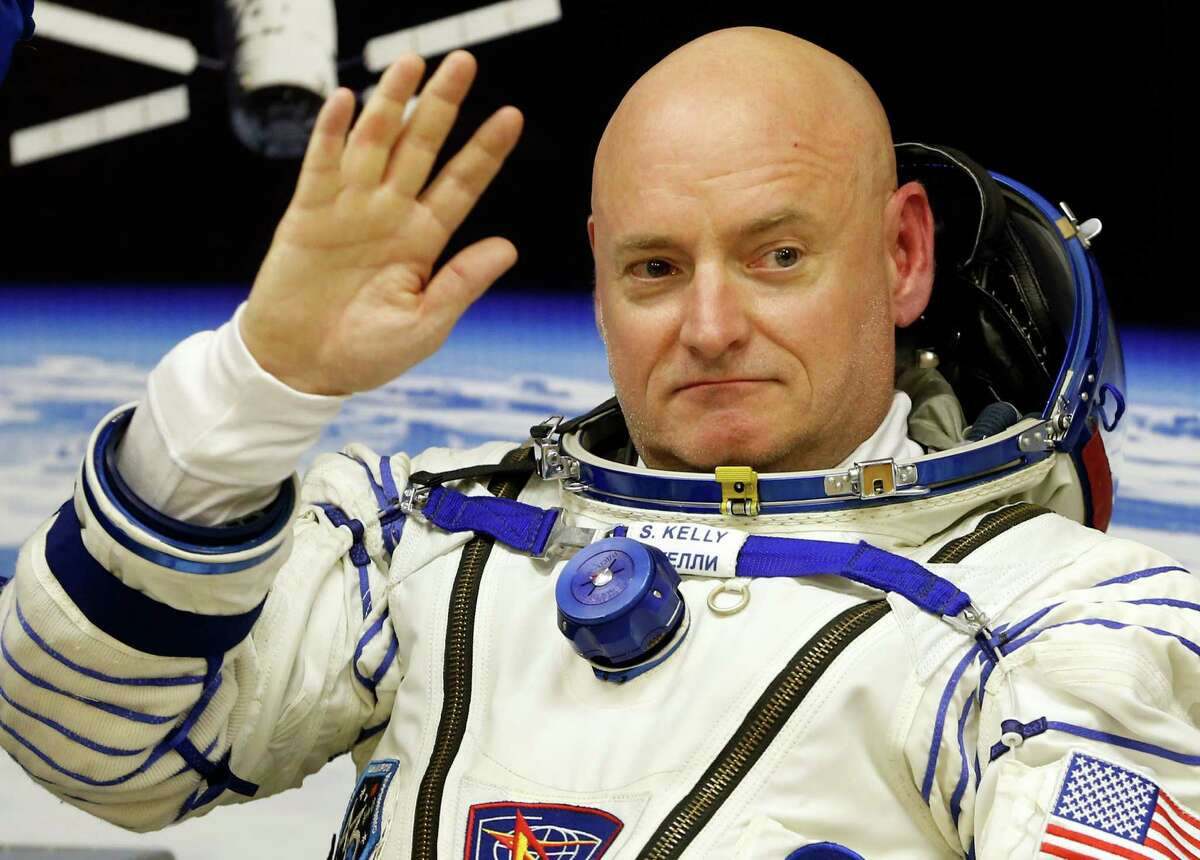 U.S. astronaut Scott Kelly, crew member of the mission to the International Space Station, ISS, gestures prior the launch of Soyuz-FG rocket at the Russian leased Baikonur cosmodrome, Kazakhstan, Friday, March 27, 2015. (AP Photo/Dmitry Lovetsky)