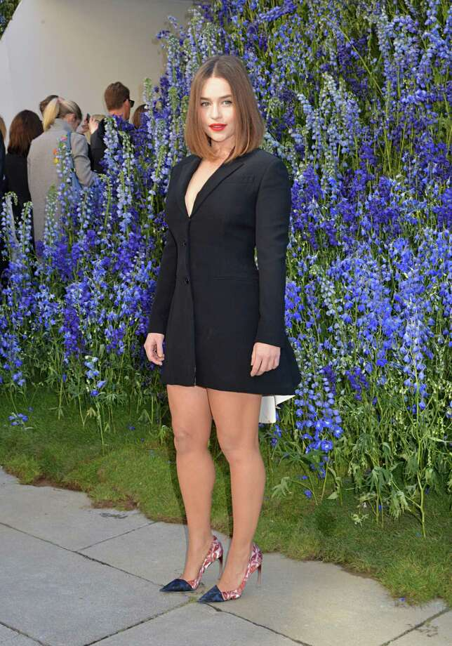 """Game of Thrones"" actress Emilia Clarke is seen at the Dior show at Paris Fashion Week. Her simple blazer dress really accents her shape and helps play up the shoes. Photo: Foc Kan, Getty Images / 2015 Foc Kan"