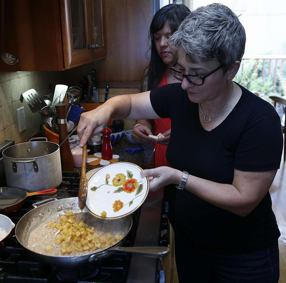 Chef Sharon Ardiana adds squash to make farrotto at home in San Francisco, Calif., on Tuesday, September 29, 2015.