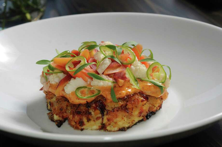 The crab cake with jumbo lump crab meat, spicy remoulade, south Texas escabeche, lime and cilantro at The Del restaurant Monday Oct. 05,2015.(Dave Rossman photo) Photo: Dave Rossman, For The Chronicle / Freelalnce
