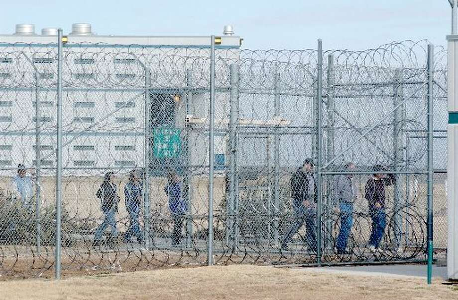 Texas Department of Criminal Justice employees exit the Clements Unit. In August, TDCJ counted 212 inmates in prisons who self-identify as transgender. Of those 212 inmates, 21 are receiving hormone therapy. Photo: AP Photo/Amarillo Globe News, Michael Schumacher
