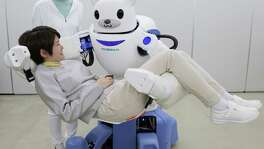 "Judson ISD teacher Joseph Jacobson says anyone curious about the future of robotics should look to Japan. This picture taken on Feb. 23, 2015, shows a polar bear robot ""Robear"" lifting a woman for a demonstration in Nagoya, central Japan. The ""Robear,"" developed by Riken Institute and Sumitomo Riko, has a polar cub-like face with big doey eyes, but packs enough power to transfer frail patients from a wheelchair to a bed or a bath."