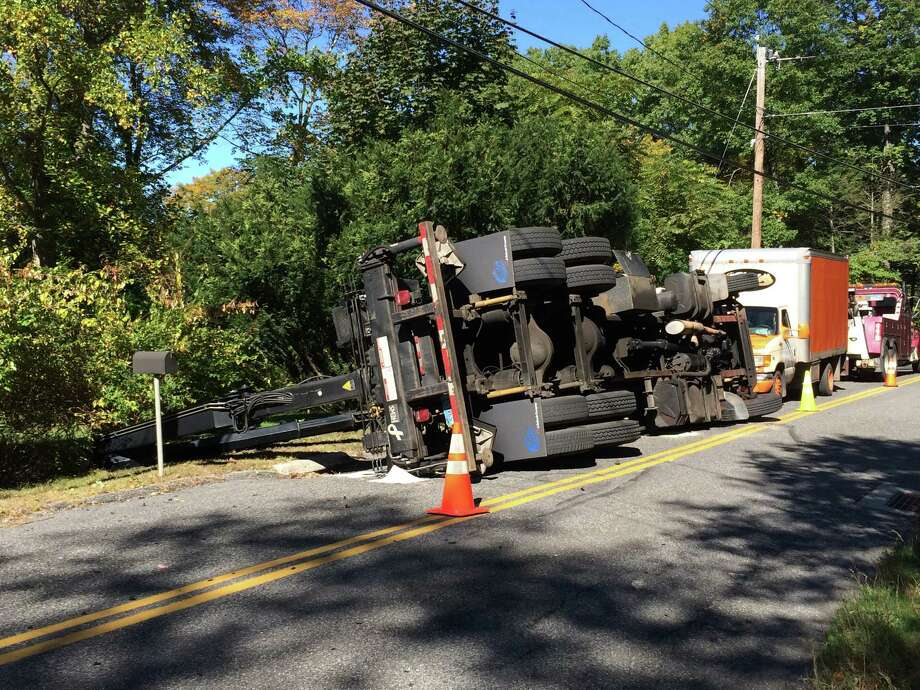A truck rolled over on Carmen Hill Rd. No. 1 on Tuesday, Oct. 6, 2015 Photo: Carol Kaliff / Hearst Connecticut Media