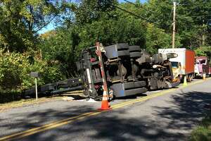 Truck rollover closes Carmen Hill Rd. No. 1 - Photo