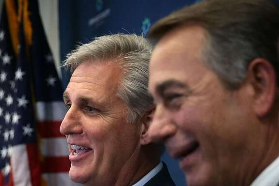 WASHINGTON, DC - SEPTEMBER 29:  U.S House Majority Leader Rep. Kevin McCarthy (R-CA) (L) and Speaker of the House Rep. John Boehner (R-OH) (R) share a moment as they speak to member of the media after a House Republican Conference meeting September 29, 2015 at the U.S. Capitol in Washington, DC. House Republicans met to discuss GOP agenda including the government funding bill.  (Photo by Alex Wong/Getty Images)