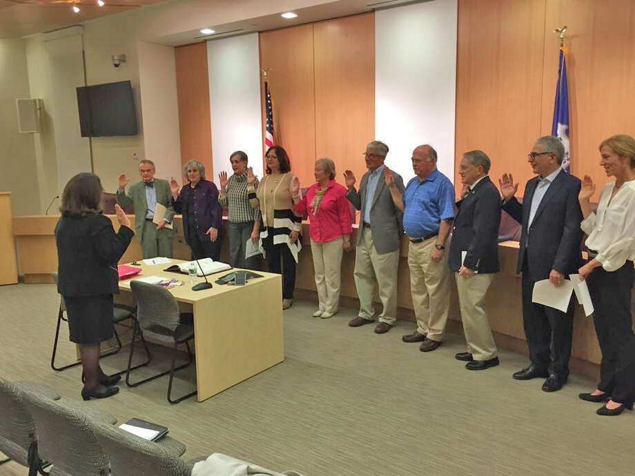 Town Clerk Claudia Weber, foreground, swears in members of the town's new Charter Revision Commission. The body will begin considering recommendations for amending the town's governing document this month, holding a public hearing on Oct. 21. Photo: Contributed Photo / New Canaan News