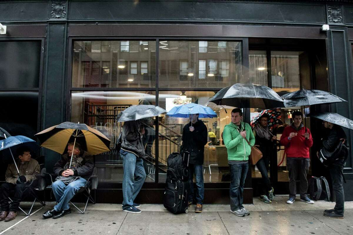 NEW YORK, NY - OCTOBER 2: Customers wait in line outside of Chick-Fil-A , a day before its opening on 37th Street and 6th Avenue, to get raffle tickets to win free food for a year on October 2, 2015 in New York City.. The fast food chicken restaurant is set to open its first store in Manhattan.