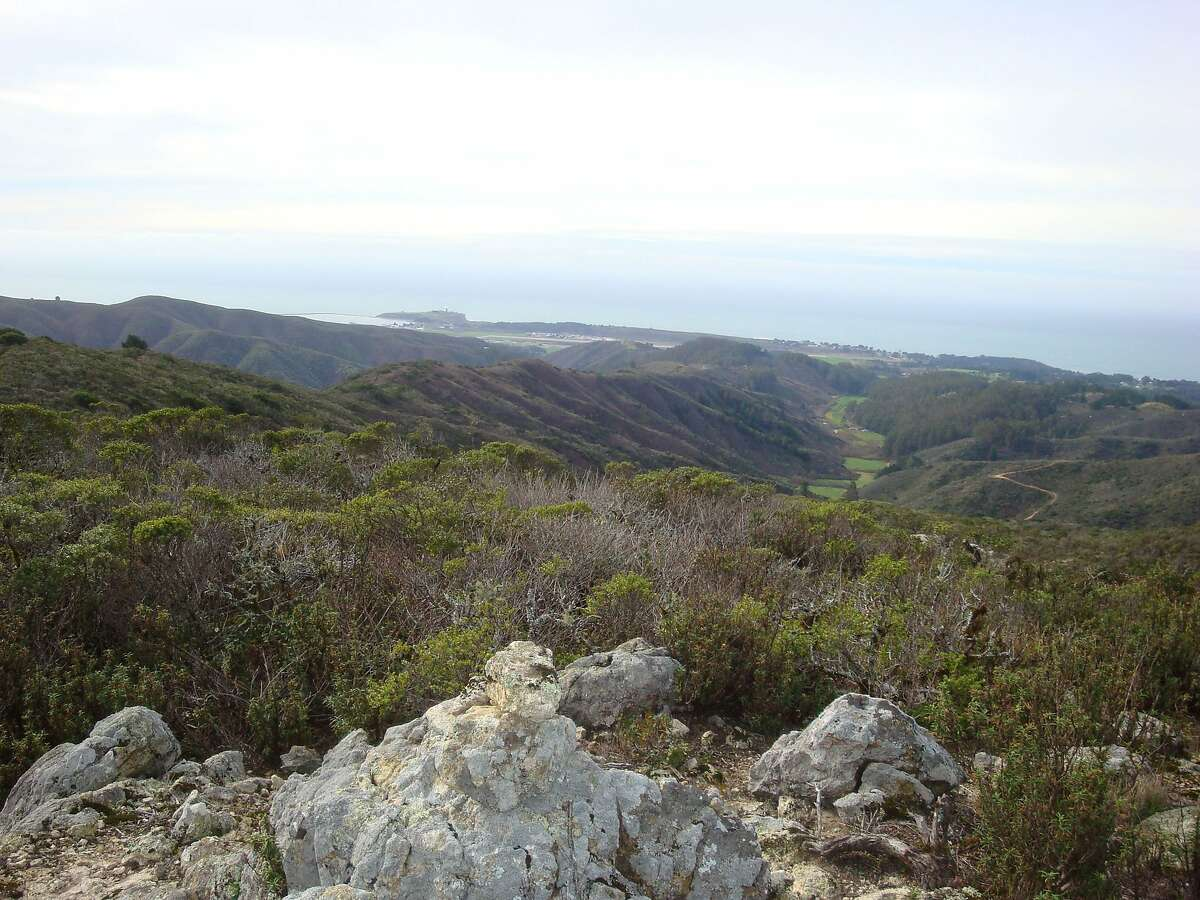 From southern ridge of Montara Mountain, you can see across coastal foothills to Pillar Point Harbor and the San Mateo County coast