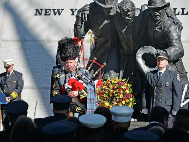 Regimental Pipe Major Joe Brady, center, plays Amazing Grace during the New York State Firefighters Memorial ceremony honoring eight fallen firefighters at the Empire State Plaza Tuesday Oct. 6, 2015 in Albany, NY.  (John Carl D'Annibale / Times Union) Photo: John Carl D'Annibale / 10033635A