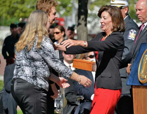 Lieutenant Governor Kathy Hochul, right, embraces family members during the New York State Firefighters Memorial ceremony honoring eight fallen firefighters at the Empire State Plaza Tuesday Oct. 6, 2015 in Albany, NY.  (John Carl D'Annibale / Times Union) Photo: John Carl D'Annibale / 10033635A