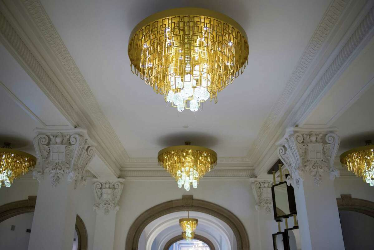 Chandeliers in the main entrace boast craftsmanship by Voss Metals, a four-generation San Antonio metal work company. At the St. Anthony Hotel in downtown San Antonio on Friday, October 2, 2015. The hotel was recently renovated after being purchased by new owners in 2012. The hotel will have a grand reopening Nov. 19.