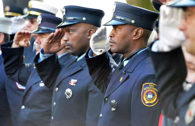 Firefighters salute during the NYS Firefighters Memorial ceremony honoring eight fallen firefighters at the Empire State Plaza Tuesday Oct. 6, 2015 in Albany, NY.  (John Carl D'Annibale / Times Union) Photo: John Carl D'Annibale / 10033635A