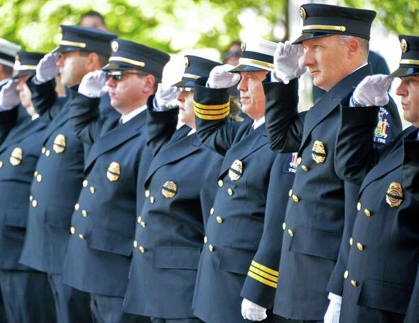 NYS firefighters salute during the NYS Firefighters Memorial ceremony honoring eight fallen firefighters at the Empire State Plaza Tuesday Oct. 6, 2015 in Albany, NY.  (John Carl D'Annibale / Times Union) Photo: John Carl D'Annibale / 10033635A