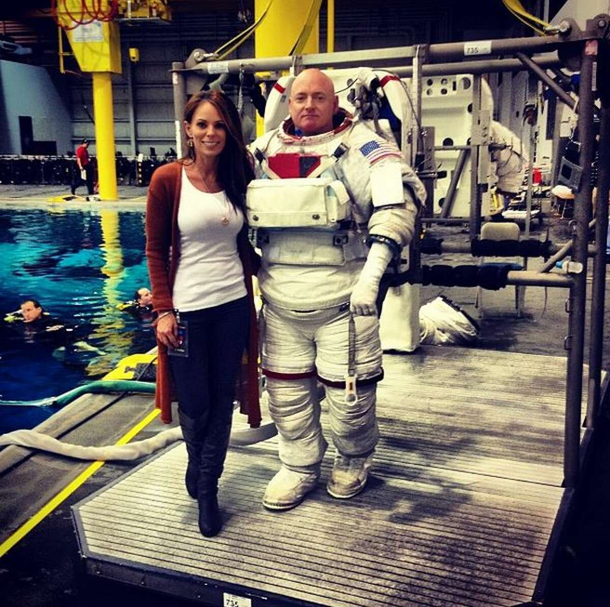 Amiko Kauderer has been in a relationship with Scott Kelly for six years. When they reminisce on this year of their relationship, it will be filled with memories of video calls and and emails between Texas and the International Space Station while he completes his year-long mission. Kelly and his twin, retired astronaut Mark Kelly, are the subjects of study for researchers who are analyzing the human body's reaction to a space trip which is double the duration of most.