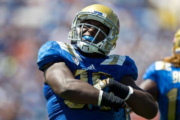 Linebacker Myles Jack #30 of the UCLA Bruins celebrates after a play against the Virginia Cavaliers during the first quarter at the Rose Bowl on September 5, 2015 in Pasadena, California. The UCLA Bruins defeated the Virginia Cavaliers 34-16. (Photo by Jason O. Watson/Getty Images)