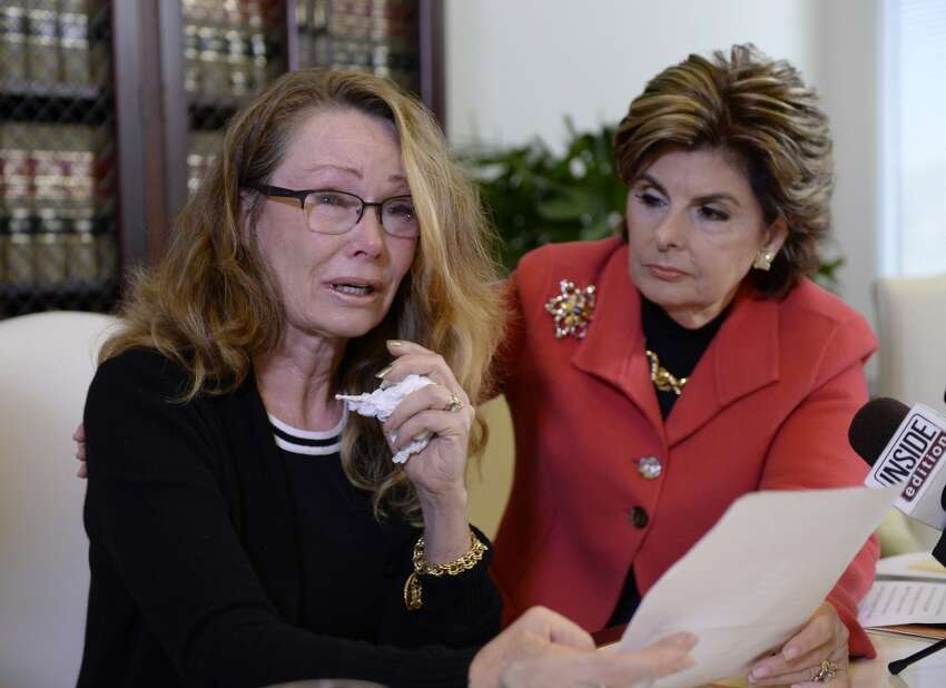 Sharon Van Ert (L) one of three new alleged sexual assault victims of comedian Bill Cosby reacts during a news conference with attorney Gloria Allred September 30, 2015, in Los Angeles, California. Cosby has been accused of sexual assault by over 30 women. (Photo by Kevork Djansezian/Getty Images)