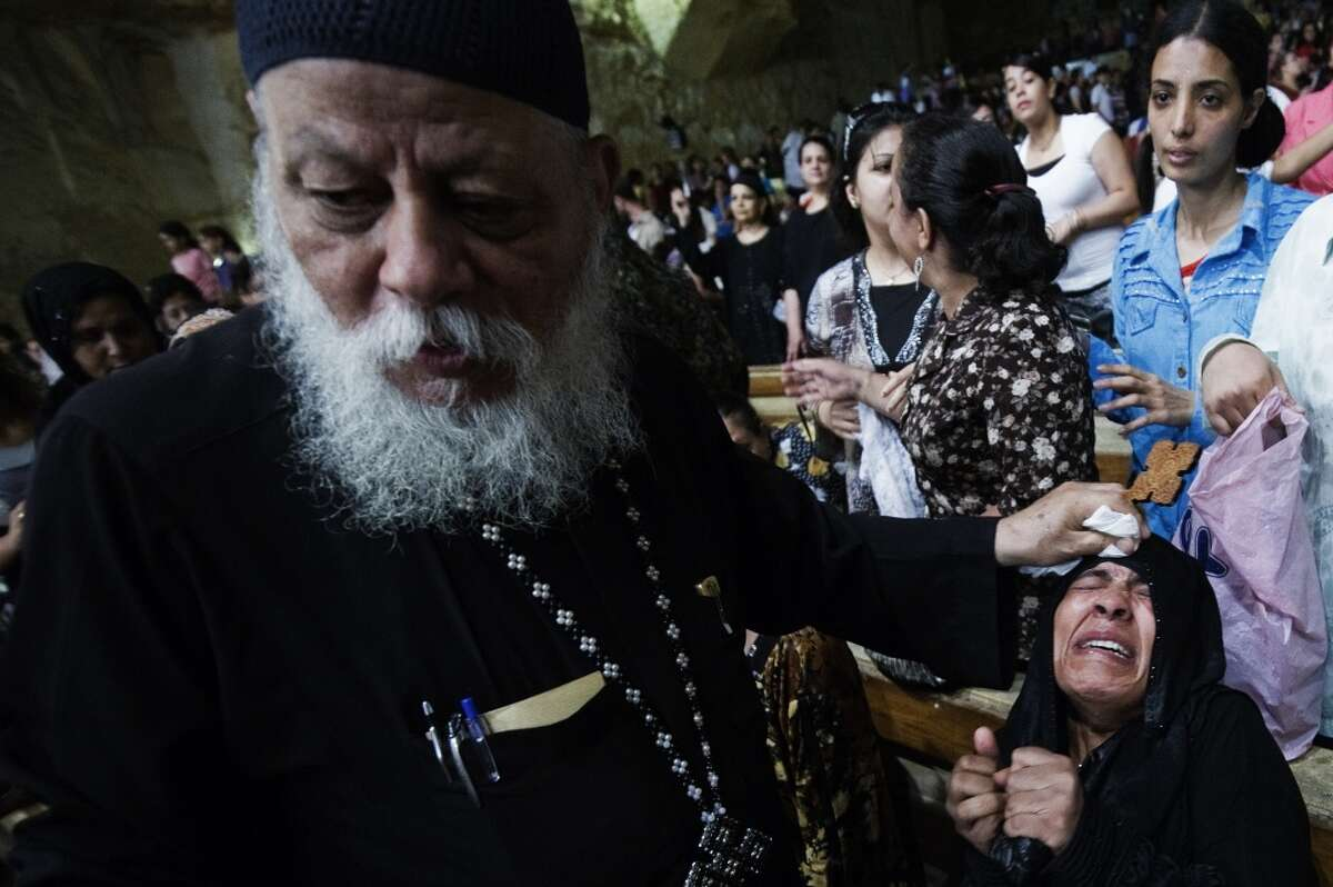 Egypt Coptic priest Father Samaan Ibrahim allegedly performs an exorcism on an Egyptian woman on July 26, 2012 at the St. Samaans (Simon) Church. Keep clicking to learn more about modern-day exorcism rituals.