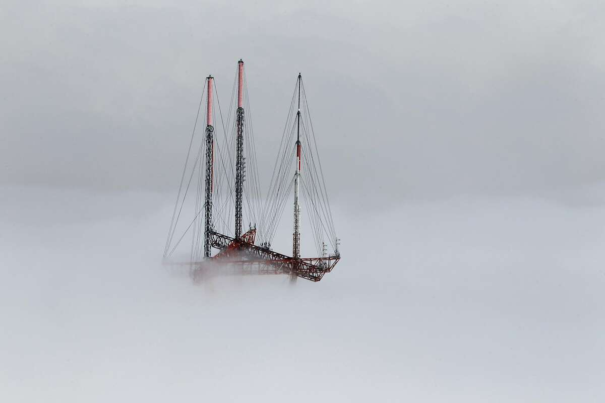 Sutro Tower emerges from a low layer of fog in San Francisco, Calif. on Friday, Sept. 28, 2012.
