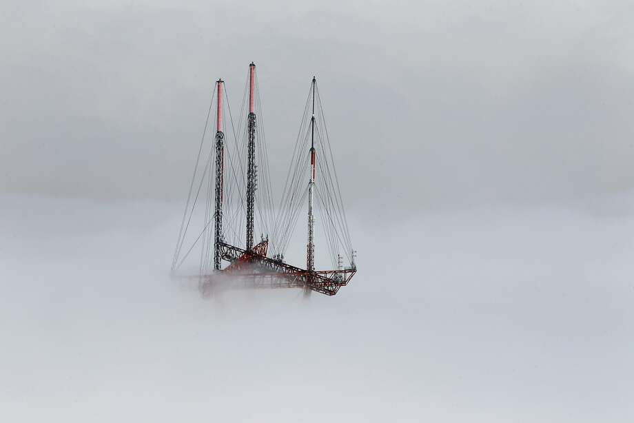 Sutro Tower emerges from a low layer of fog in San Francisco in 2012. Photo: Paul Chinn, The Chronicle