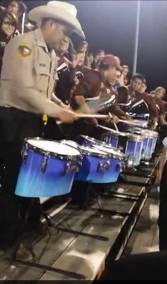 Last Saturday while Atascosa Deputy Sheriff A.J. Mendez was on duty to escort the Poteet High School Band during a football game, he picked up a pair of drumsticks and fell in line with the group of teenager musicians as cameras were rolling.