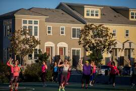 A group of women exercise to the sounds of samba and salsa in one of the many parks in the emerging Bay Meadows infill community that has replaced the old racetrack in San Mateo on Monday, Oct. 5, 2015 in San Mateo, Calif.