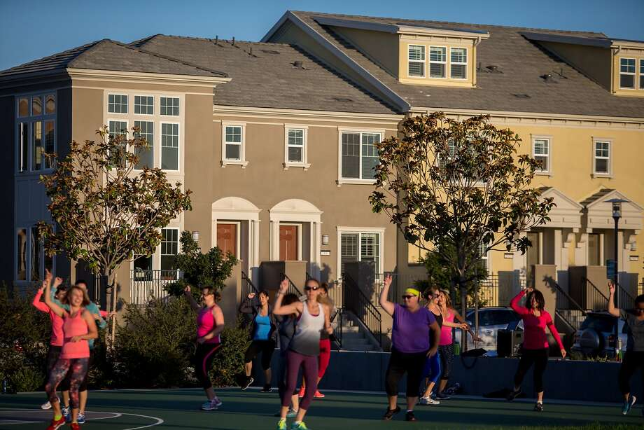 An exercise class moves to the beat of samba and salsa in one of the many parks in the emerging Bay Meadows infill community, which has replaced the old Bay Meadows racetrack. Photo: Nathaniel Y. Downes, The Chronicle
