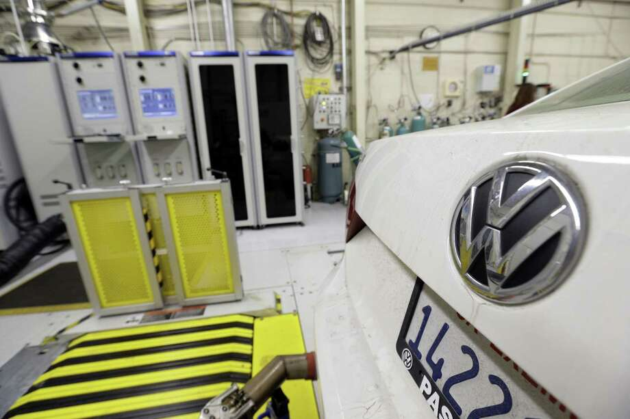 A 2013 Volkswagen Passat with a diesel engine's emissions are  evaluated at a California facility. Photo: Nick Ut, STF / AP