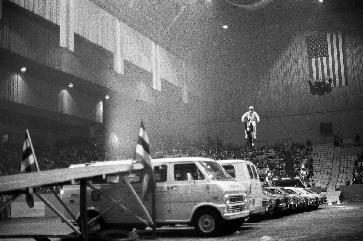 Evel Knievel makes his record 12-car motorcycle jump at the Cow Palace in 1972.