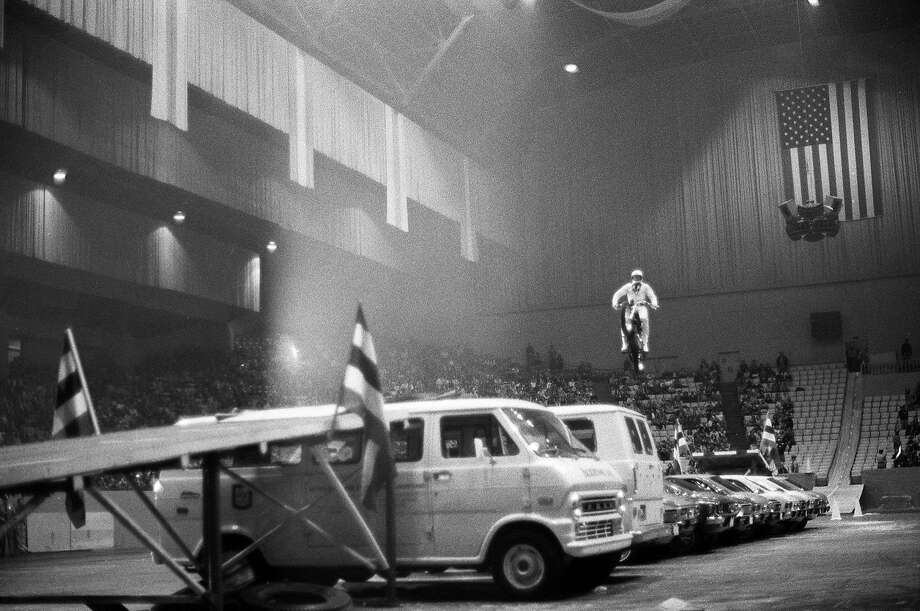 Evel Knievel makes his record 12-car motorcycle jump at the Cow Palace in 1972. Photo: Chronicle File, SFC
