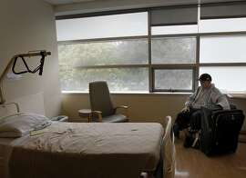 Tim Martin sits alone in his new spacious room at Laguna Honda hospital Wednesday August 21, 2013. Tim Martin, a man who is blind, deaf and unable to speak, arrived in San Francisco, Calif. from Reno, Nevada in the spring of 2013.  He had previously been in a Reno area mental institution.