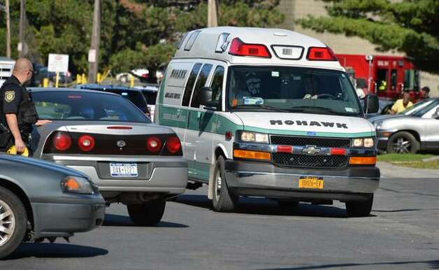 An ambulance carries a 16-year-old male stabbing victim from Manning and North Manning Tuesday Oct. 6, 2015, in Albany, N.Y. (John Carl D'Annibale / Times Union)