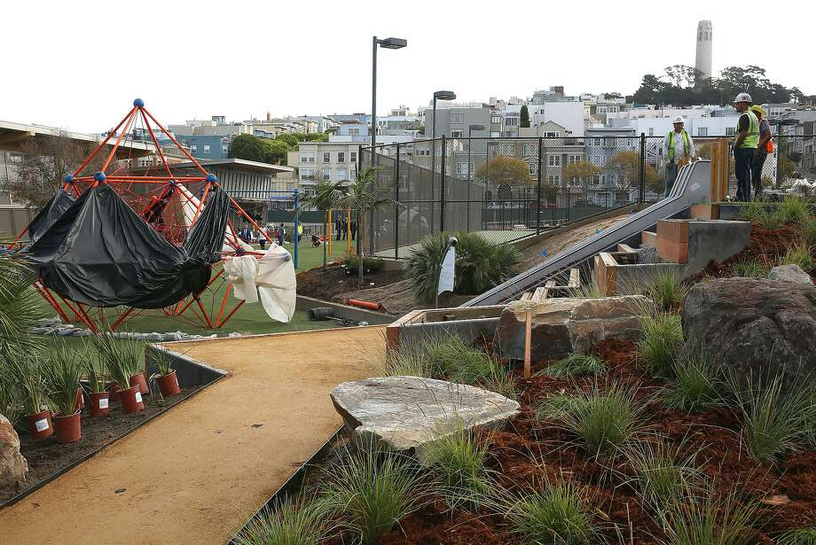 Crews work on installing equipment at the Joe DiMaggio Playground in North Beach. Neighbors raised more than $900,000 for the project, which took more than 10 years to move into the construction phase. It is scheduled to open on Nov. 14. Photo: Liz Hafalia, The Chronicle