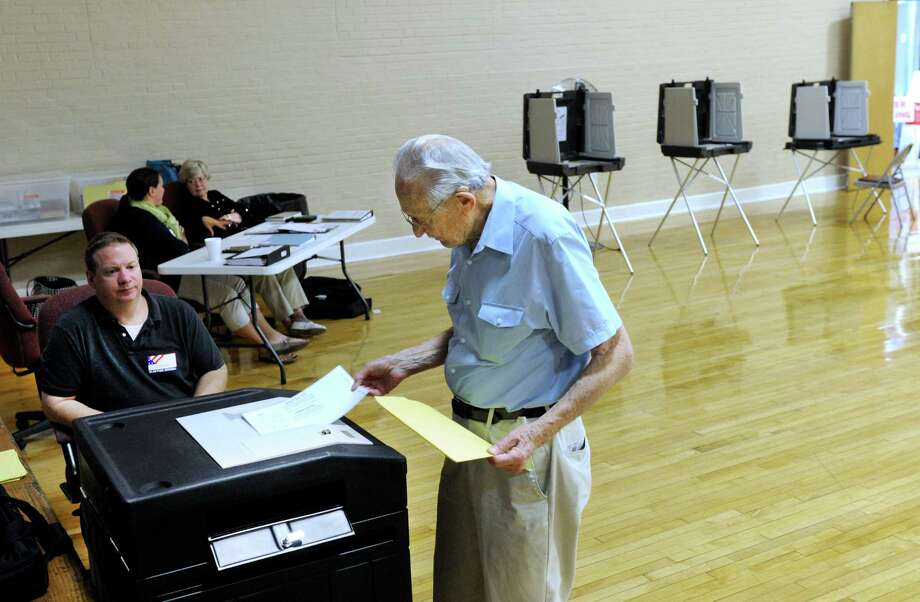Bernie Lichtenstein casts his ballot in the Republican Primary for First Selectman in Bethel Wednesday at the Bethel Municipal Center, Sept. 16, 2015.  Left is Chris Nazro, a tabulator tender. Photo: Carol Kaliff / Hearst Connecticut Media / The News-Times
