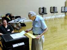 Bernie Lichtenstein casts his ballot in the Republican Primary for First Selectman in Bethel Wednesday at the Bethel Municipal Center, Sept. 16, 2015.  Left is Chris Nazro, a tabulator tender.