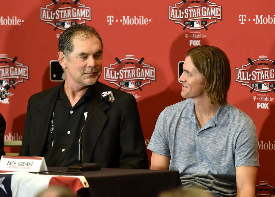 Giants manager Bruce Bochy and Dodgers pitcher Zack Greinke speak to reporters during the All Star Media Availability Day in Cincinnati in July. Photo: Mark Cunningham, MLB Photos Via Getty Images