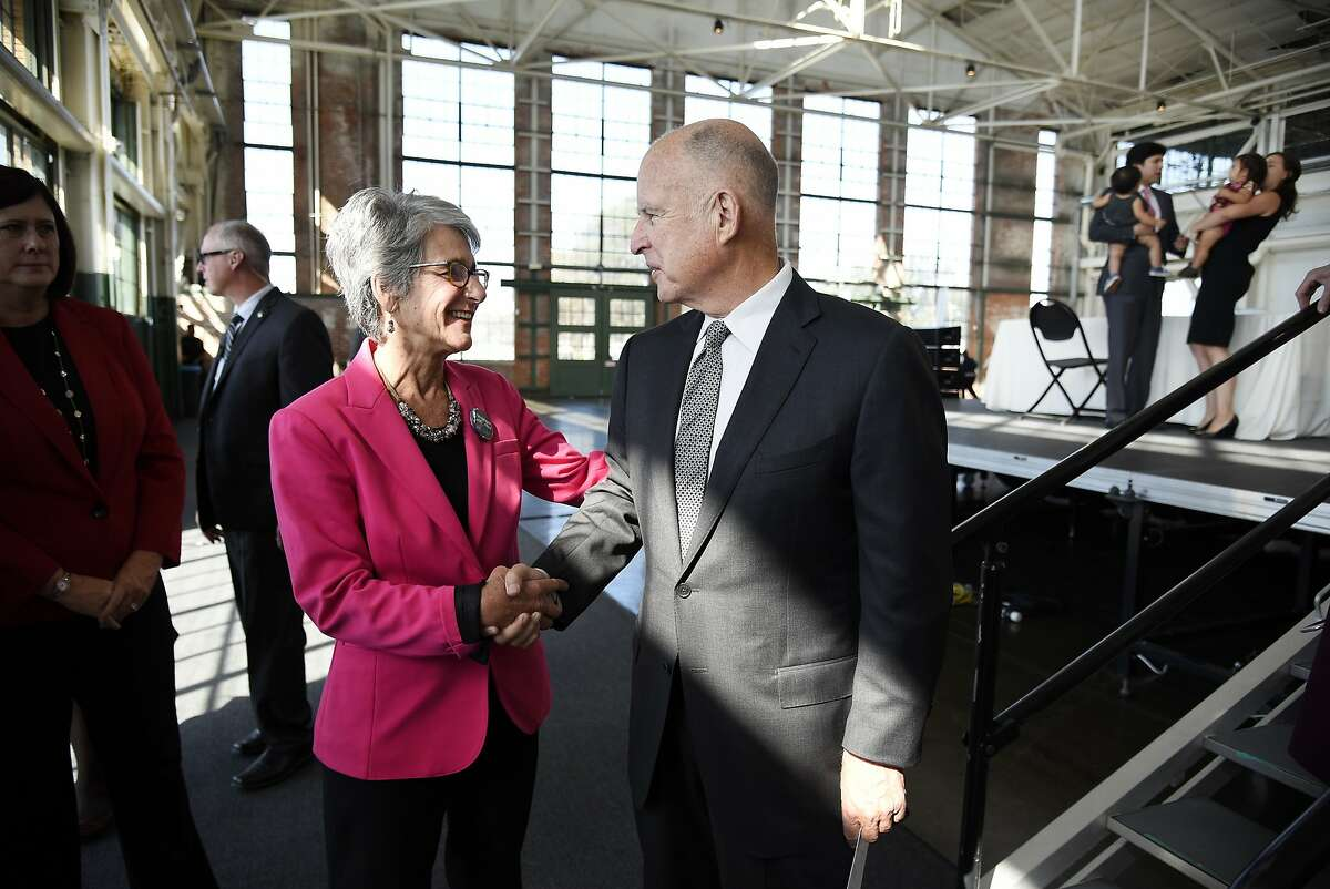 Governor Jerry Brown shakes hands with Senator Hanna-Beth Jackson, D-Santa Barbara, author of the California Fair Pay Act Ð SB 358, following the Governor's signing of the bill into law during a ceremony held in the Craneway Pavilion at Rosie the Riveter-WWII Home Front National Historical Park in Richmond, CA Tuesday, October 6, 2015.
