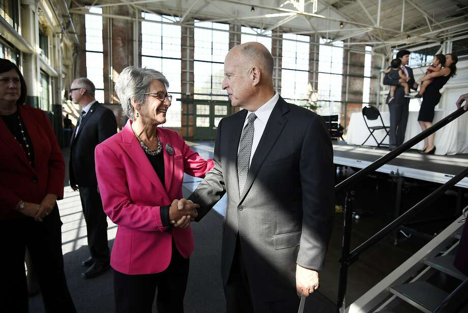 Governor Jerry Brown shakes hands with Senator Hanna-Beth Jackson, D-Santa Barbara, author of the California Fair Pay Act Ð SB 358, following the Governor's signing of the bill into law during a ceremony held in the Craneway Pavilion at Rosie the Riveter-WWII Home Front National Historical Park in Richmond, CA Tuesday, October 6, 2015. Photo: Michael Short, Special To The Chronicle