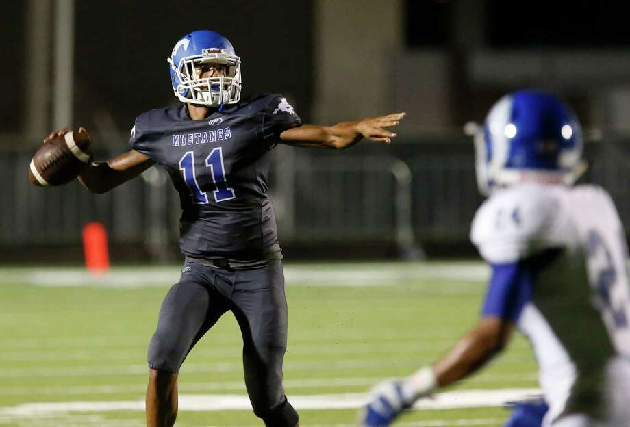 John Jay quarterback Moses Reynolds attempts to pass against Del Rio during their game at Gustafson Stadium on Friday, Sept. 11, 2015. Photo: Kin Man Hui /San Antonio Express-News / ©2015 San Antonio Express-News