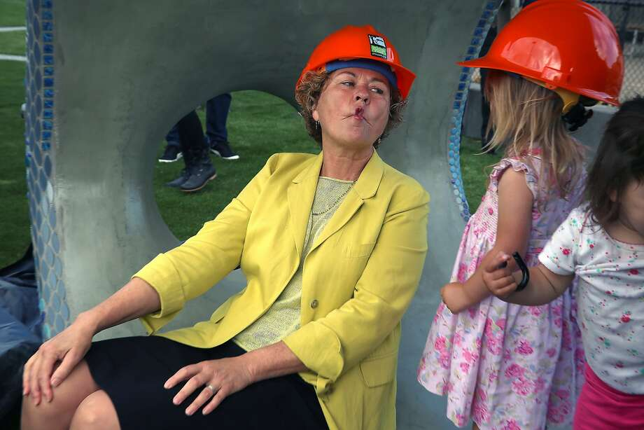 Joe DiMaggio Playground in San Francisco, Calif., on Tuesday, October 6, 2015.  SF supervisor Julie Christensen makes a fish face for Virginia Hain, 2 years old, in the new fish sculpture at the construction zone of Joe DiMaggio Playground in San Francisco, Calif., on Tuesday, October 6, 2015. Photo: Liz Hafalia, The Chronicle