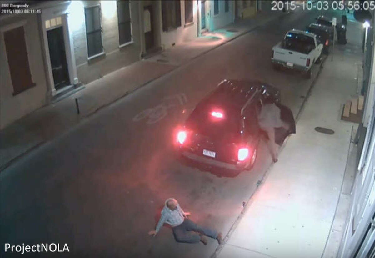Surveillance cameras catch two women assaulting and robbing a man in New Orleans' historic French Quarter earlier October 2015. A bystander walks upon the scene, but keeps right on strolling. The women eventually leave in a dark SUV.