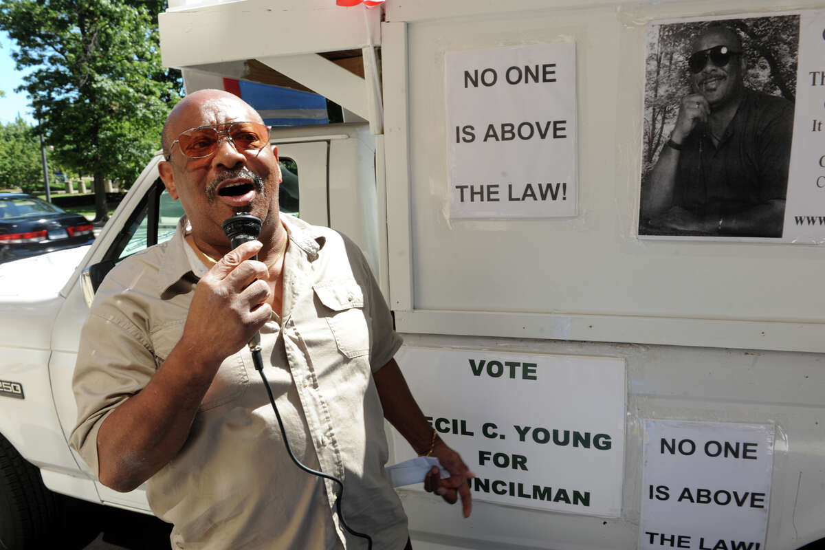 Cecil Young speaks through a public address system rigged up on his truck in 2013. A divided Bridgeport City Council voted 9 to 4, with three abstentions, to pay Young $85,000 to drop a lawsuit he filed in 2012 after being wrestled onto a bench in the City Hall Annex meeting room.