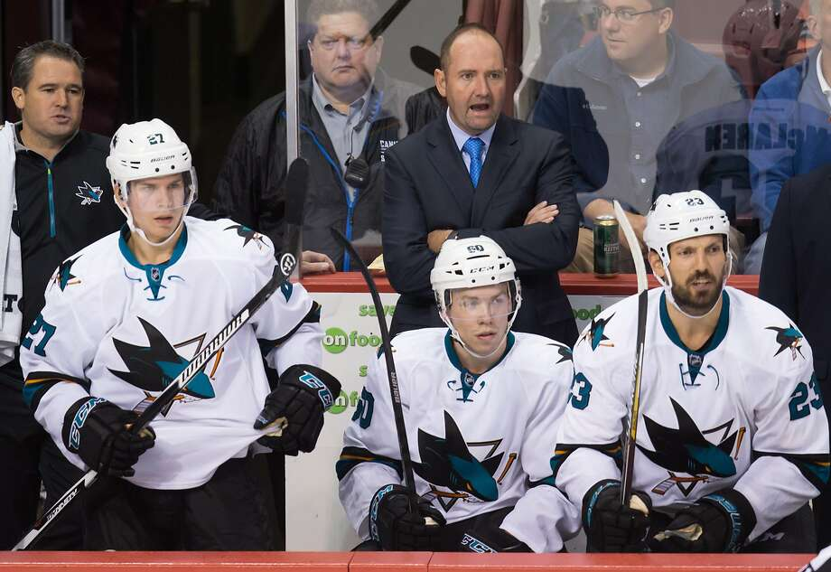 San Jose Sharks coach Peter DeBoer stands behind Joonas Donskoi (left), Rourke Chartier and Frazer McLaren. Photo: Darryl Dyck, Associated Press