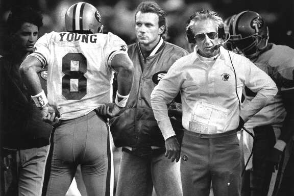 San Francisco 49er Steve Young talks to Joe Montana and George Seifert on the sidelines  Photo shot 08/31/1990 Photo ran 09/171991, p. D1